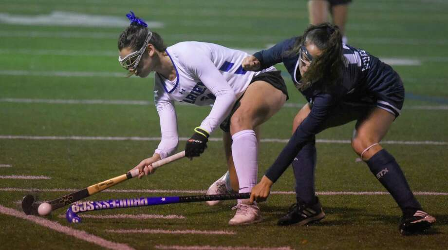 Darien's Lindsey Olson (24) and Staples' Julia DiConza (14) battle for the ball during the FCIAC field hockey final between Darien and Staples at Brien McMahon on Thursday, Nov. 7, 2019. Photo: Dave Stewart / Hearst Connecticut Media / Hearst Connecticut Media