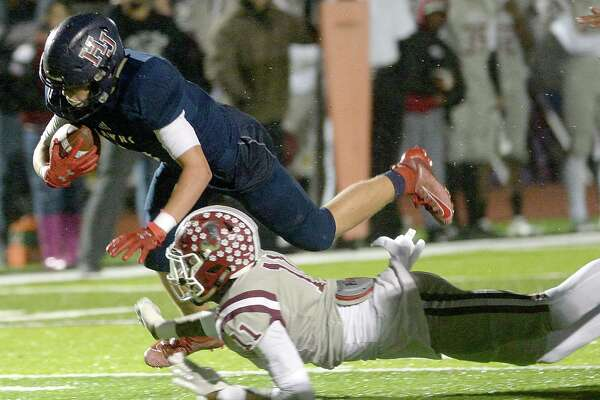 Hardin - Jefferson's Sam Dickerson is tripped up by Jasper's Terrien Collins during their opening round of playoffs Thursday in Vidor. Photo taken Thursday, November 14, 2019 Kim Brent/The Enterprise