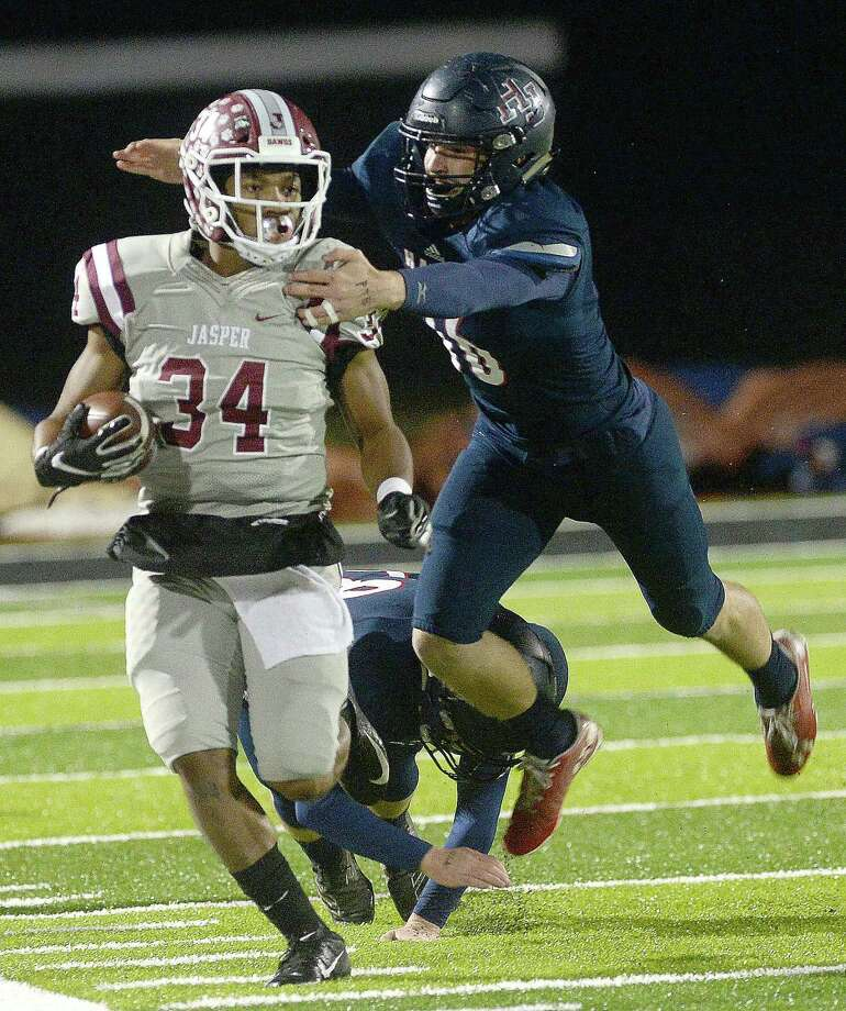 Hardin - Jefferson's Jacob Connolly forces Jasper's Carl Limbrick out of bounds during their opening round of playoffs Thursday in Vidor. Photo taken Thursday, November 14, 2019 Kim Brent/The Enterprise Photo: Kim Brent / The Enterprise / BEN