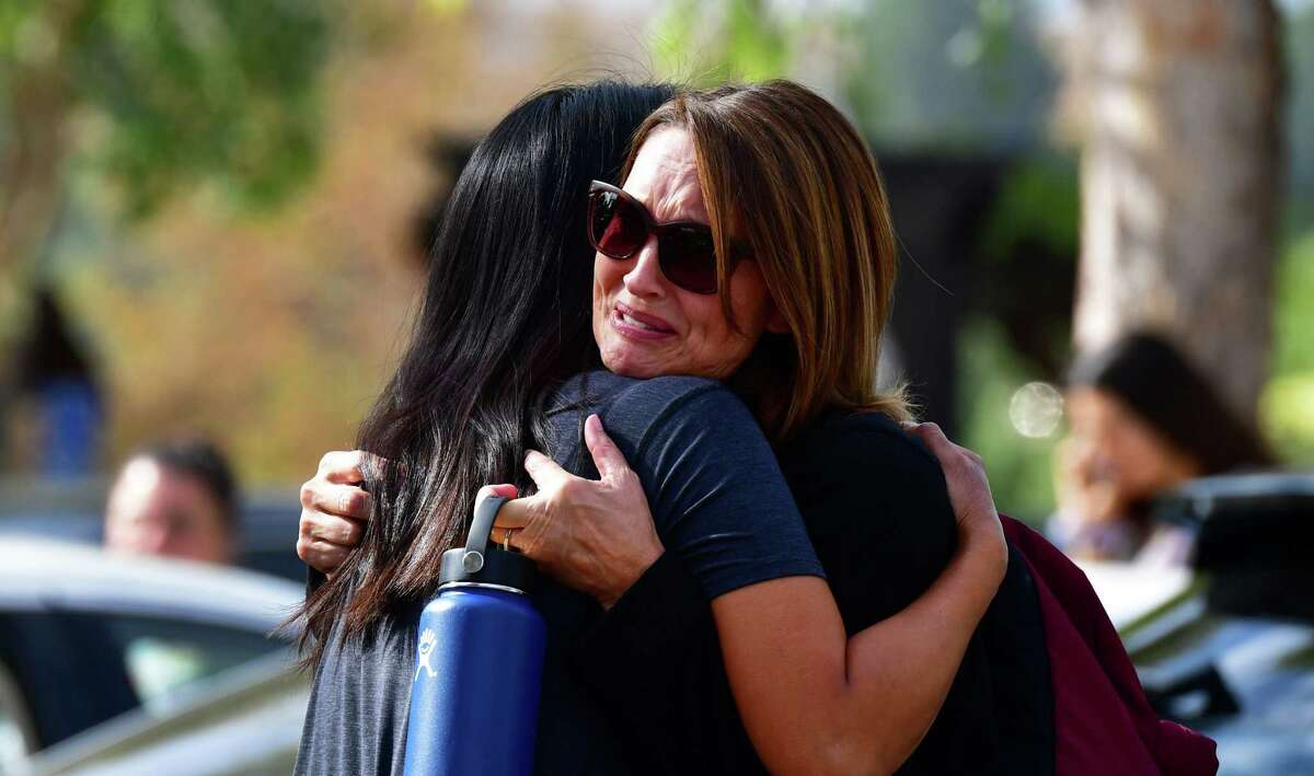 """Grieving students from Saugus High School reunite with their parents at Central Park in Santa Clarita, California, on November 14, 2019. - A teenage boy gunned down fellow students at a California high school on his 16th birthday Thursday, killing two and wounding another three before turning the pistol on himself. The gunman was taken into custody in """"grave"""" condition, police said, as officers stormed Saugus High School in Santa Clarita -- the latest in a relentless cycle of classroom shootings that have left around 300 youngsters dead over two decades. (Photo by Frederic J. BROWN / AFP) (Photo by FREDERIC J. BROWN/AFP via Getty Images)"""