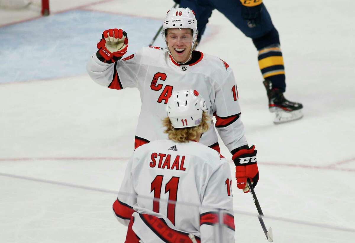 Carolina Hurricanes forwards Ryan Dzingel (18) and Jordan Staal (11) celebrate a goal during the first period of an NHL hockey game against the Buffalo Sabres, Thursday, Nov. 14, 2019, in Buffalo N.Y. (AP Photo/Jeffrey T. Barnes)