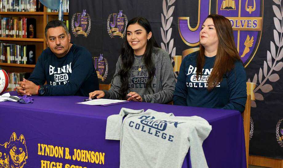 LBJ's Yaretzi Ortiz is joined by her parents Jose and Dora as she signs her National Letter of Intent to play volleyball for Blinn College Thursday at LBJ. Photo: Danny Zaragoza /Laredo Morning Times / Laredo Morning Times