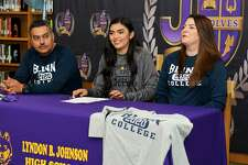 LBJ's Yaretzi Ortiz is joined by her parents Jose and Dora as she signs her National Letter of Intent to play volleyball for Blinn College Thursday at LBJ.