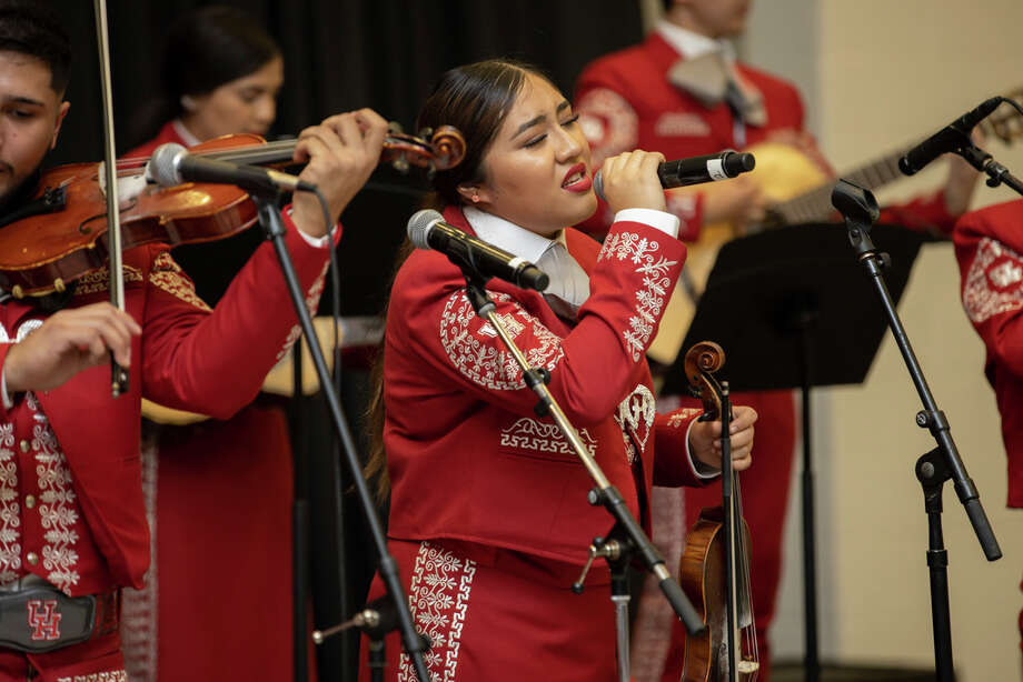 The Mariachi Pumas debuted in Bert F. Winston Band Complex in Houston, Thursday, Nov. 14, 2019. Wendy Gutierrez singing a version of Perfect by Ed Sheern as a dedication from Mariachi Pumas Director, Jose Longoria, to his wife. Photo: Gustavo Huerta, Contributor / © 2019 Gustavo Huerta / Houston Chronicle