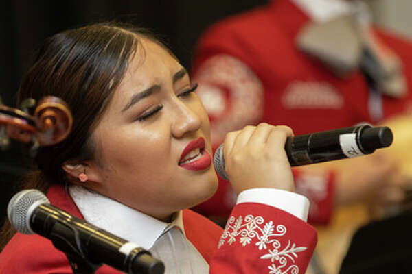 The Mariachi Pumas debuted in Bert F. Winston Band Complex in Houston, Thursday, Nov. 14, 2019. Wendy Gutierrez singing a version of Perfect by Ed Sheern as a dedication from Mariachi Pumas Director, Jose Longoria, to his wife.