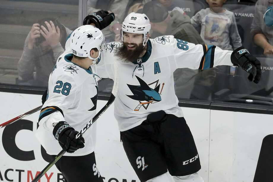 Sharks defenseman Brent Burns (right) celebrates his go-ahead goal with Timo Meier after Burns scores on a power play with just over eight minutes to go in the final period. Photo: Chris Carlson / Associated Press