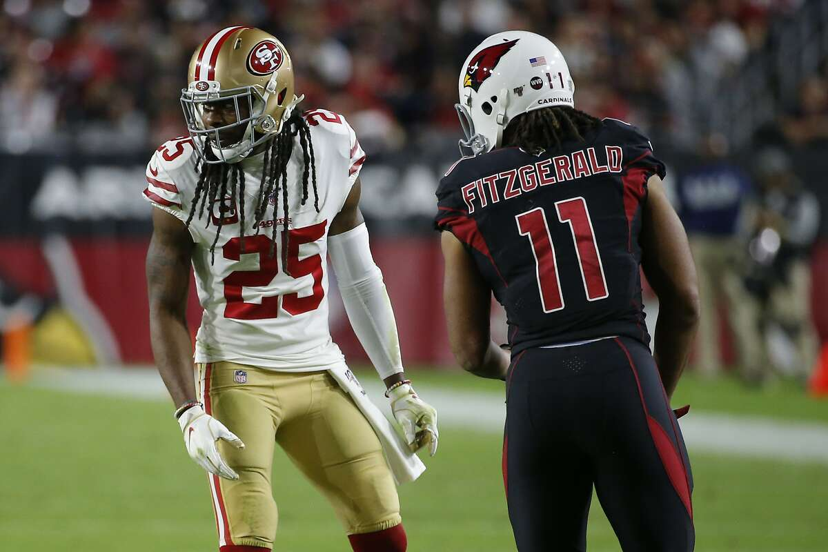 San Francisco 49ers cornerback Richard Sherman (25) and Arizona Cardinals wide receiver Larry Fitzgerald (11) line up during the second half of an NFL football game, Thursday, Oct. 31, 2019, in Glendale, Ariz. (AP Photo/Rick Scuteri)