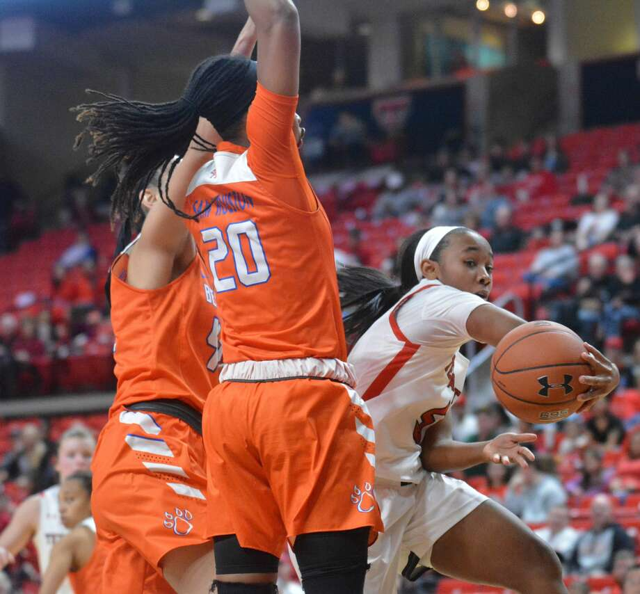 Texas Tech's Jo'Nah Johnson scoops a pass around Sam Houston State defenders La'Sha Haynes (20) and Kiera McKinney during their NCAA women's basketball game on Thursday in the United Supermarkets Arena. Photo: Nathan Giese/Planview Herald
