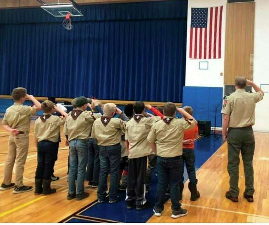 "During the Veterans Day Assembly, Cub Scout Troop 3123 led the staff and students in the ""Pledge of Allegiance."" (Courtesy photo)"