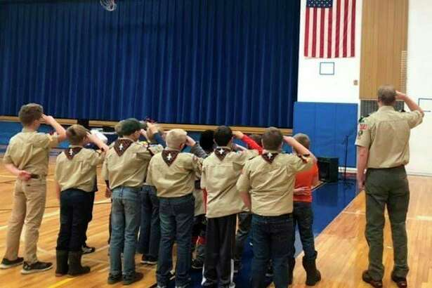 """During the Veterans Day Assembly, Cub Scout Troop 3123 led thestaff and studentsin the """"Pledge of Allegiance."""" (Courtesy photo)"""