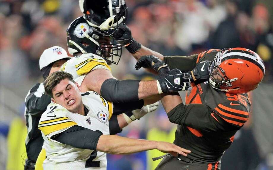 Cleveland Browns defensive end Myles Garrett (95) hits Pittsburgh Steelers quarterback Mason Rudolph (2) with a helmet during the second half of an NFL football game Thursday, Nov. 14, 2019, in Cleveland. (AP Photo/David Richard) Photo: David Richard, Associated Press / Copyright 2019 The Associated Press. All rights reserved.