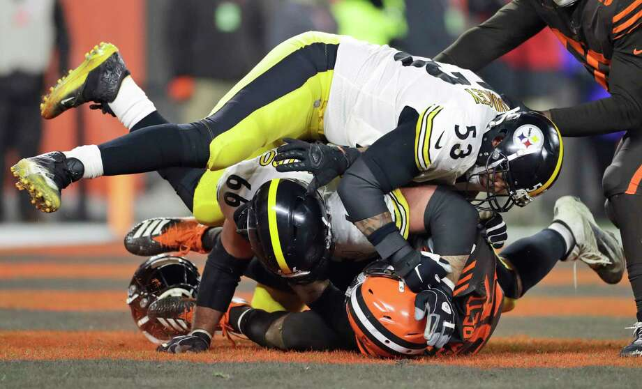 Cleveland Browns defensive end Myles Garrett, bottom, and, Pittsburgh Steelers center Maurkice Pouncey (53) and offensive guard David DeCastro (66) fall to the turf during a brawl in the second half of an NFL football game Thursday, Nov. 14, 2019, in Cleveland. The Browns won 21-7. (AP Photo/Ron Schwane) Photo: Ron Schwane, Associated Press / Copyright 2019 The Associated Press. All rights reserved.