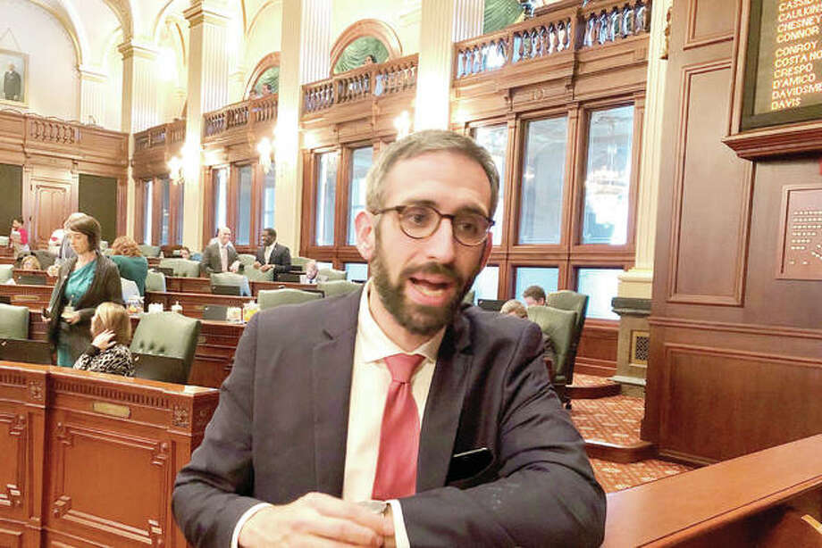State Rep. Will Guzzardi, D-Chicago, speaks to reporters after the House voted 100-13 to limit out-of-pocket costs for prescription insulin to $100 a month. The Senate also has approved the idea. Photo: John O'Connor | AP