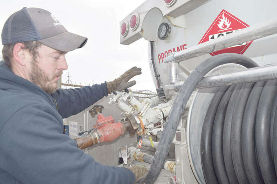 Cody Woods, a service technican for Ferrellgas, fills his tank Thursday in preparation for more propane deliveries. Photo: Samantha McDaniel-Ogletree | Journal-Courier