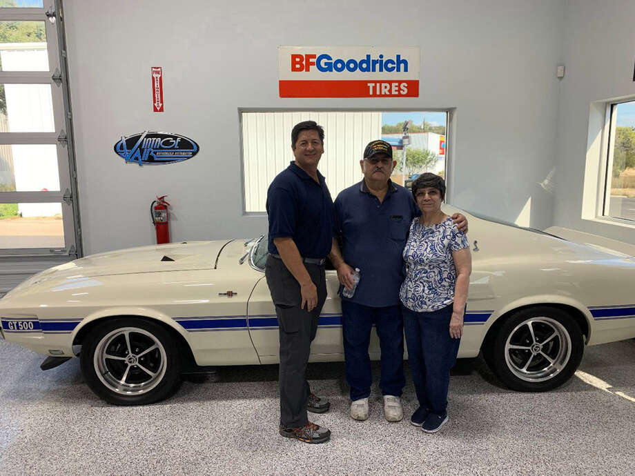 Rudy Quinones, owner of Renown Auto Restoration in San Antonio, left, with Albert Bringas and his wife, Sylvia, a few days after Quinones paid off the Bringases' mortgage. Photo: Courtesy Of Scott Lewis / Handout