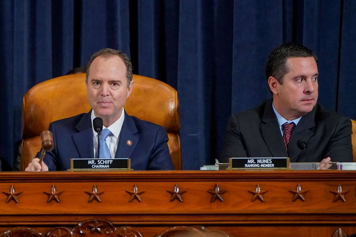 House Intelligence Committee Chairman Adam Schiff (D-CA) uses his gavel next to ranking member Representative Devin Nunez (R-CA) during the House Permanent Select Committee on Intelligence impeachment inquiry, with former US ambassador to Ukraine Marie Yovanovitch, into US President Donald Trump, on Capitol Hill on November 15, 2019 in Washington DC. - Public impeachment hearings resume Friday with the testimony of former ambassador to Ukraine Marie Yovanovitch, who says she was ousted because the Trump administration believed she would not go along with plans to pressure Ukraine to investigate Democrat Joe Biden, a potential Trump White House rival in 2020.
