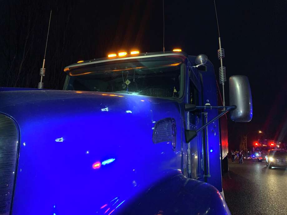 Photos from the scene where the driver of a sedan shot at a semitrailer-tractor after a crash on Interstate 5 in Tacoma on Thursday night. Photo: Courtesy WSP