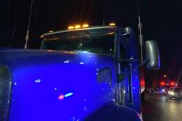 Photos from the scene where the driver of a sedan shot at a semitrailer-tractor after a crash on Interstate 5 in Tacoma on Thursday night.