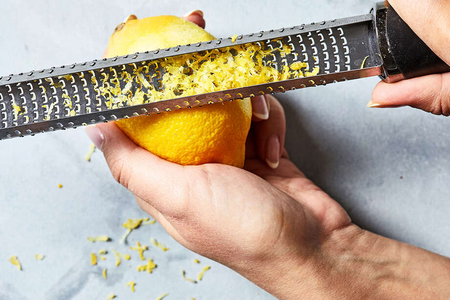 A rasp-style grater is an ideal tool for when you want a very fine texture of an ingredient like a citrus zest but it also has other less-obvious uses like smoothing off the edges of cakes. Photo: Photo For The Washington Post By Stacy Zarin Goldberg / For The Washington Post