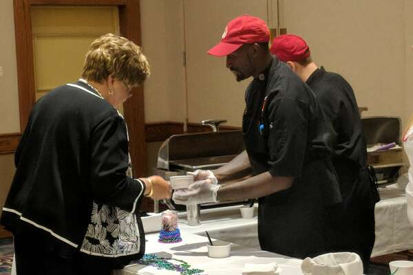 Many area eateries served up the jambalaya, comfort food and sweets for sixth annual Adoption Option Inc. Jambalaya and Jazz fundraiser Thursday at The Great Hall Banquet & Convention Center in Midland. (Tereasa Nims/for the Daily News)