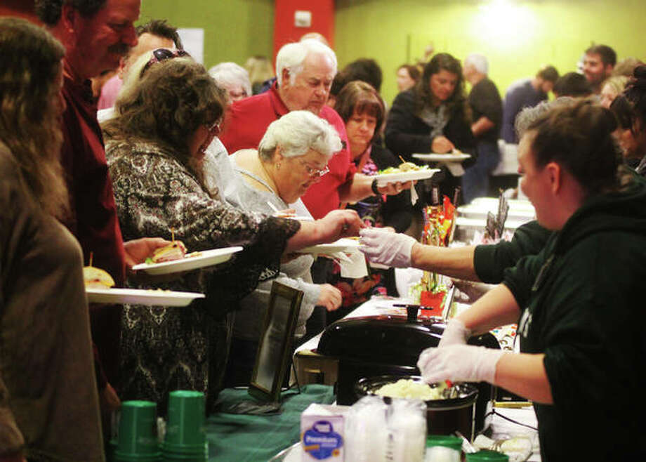 People line up for samples at last year's Taste of Downtown, an annual fundraiser for Alton Main Street held Thursday in the Music Hall at the Argosy Casino.This year's event is set for Thursday, Nov. 21 at the casino.