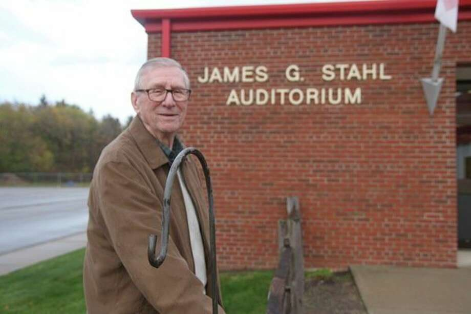 Jim Stahl poses for a photo in front of the James G. Stahl Auditorium in Caseville, where he was a teacher, coach, bus driver and even superintendent. (Rich Harp/Huron Daily Tribune)