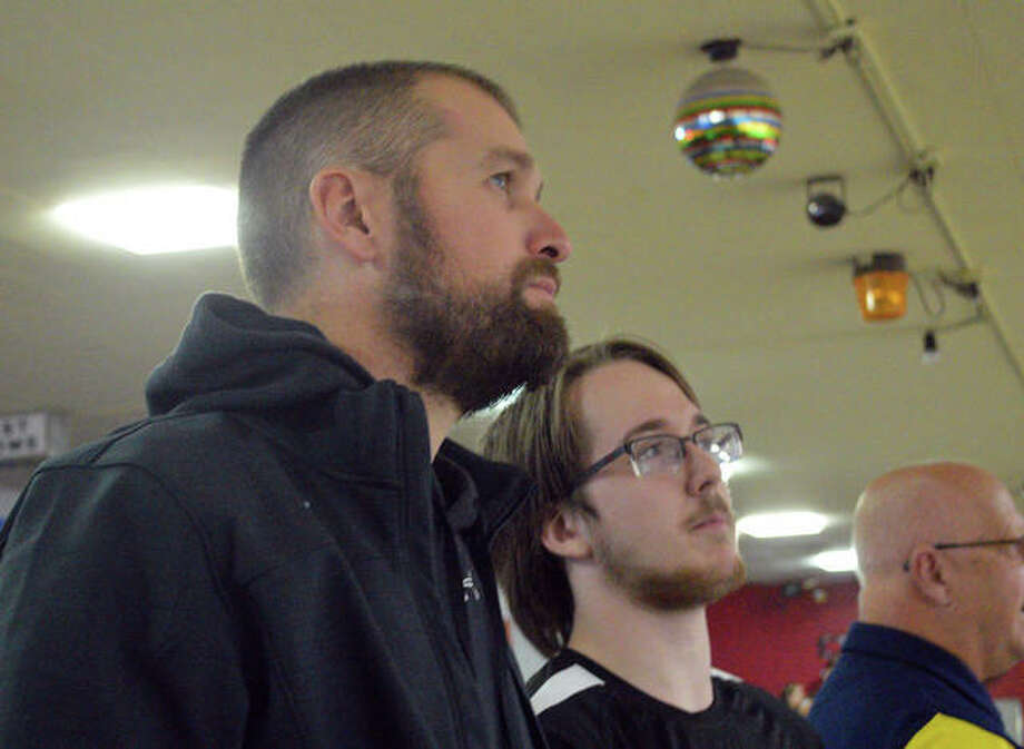 Edwardsville boys bowling coach Craig Ohau, left, watches the action along with EHS senior Michael Jenkins on Thursday at Bel-Air Bowl in Belleville during the second round of the Southwestern Conference Tournament. Photo: Scott Marion/The Intelligencer