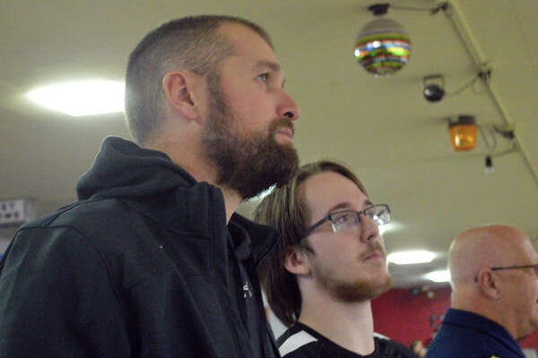 Edwardsville boys bowling coach Craig Ohau, left, watches the action along with EHS senior Michael Jenkins on Thursday at Bel-Air Bowl in Belleville during the second round of the Southwestern Conference Tournament.