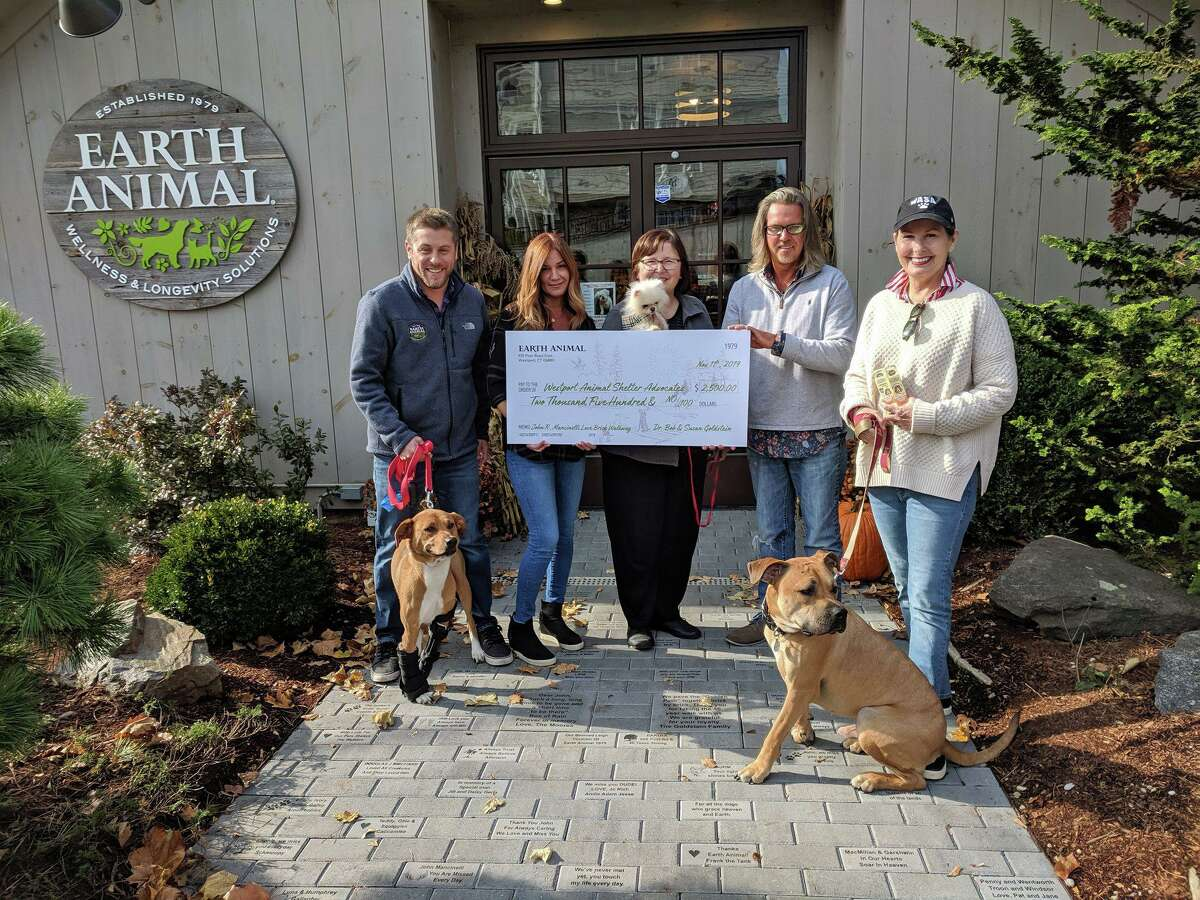 Earth Animal recently donated $2,500 to the Westport Animal Shelter Advocates. Earth Animal received the donations for its Love Brick Walkway in celebration of its new location in Westport. Pictured are Chris Wakeman and KJ Nicols, of Earth Animal store; Susan Pike, WASA; Nick Alexis, Earth Animal store; and Julie Loparo, WASA.