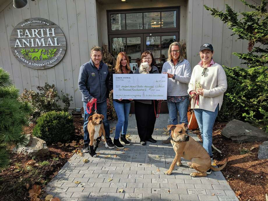 Earth Animal recently donated $2,500 to the Westport Animal Shelter Advocates. Earth Animal received the donations for its Love Brick Walkway in celebration of its new location in Westport. Pictured are Chris Wakeman and KJ Nicols, of Earth Animal store; Susan Pike, WASA; Nick Alexis, Earth Animal store; and Julie Loparo, WASA. Photo: Contributed /