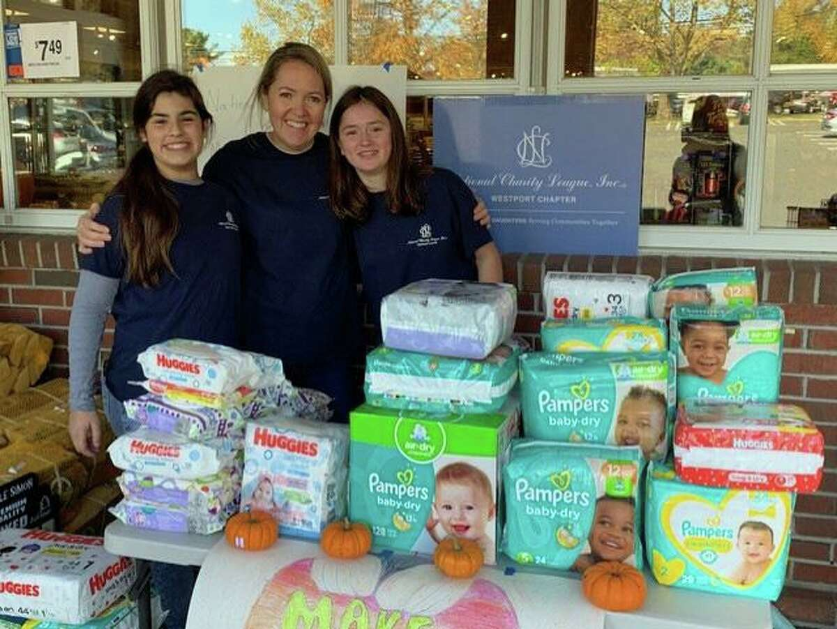 Members of the National Charity League, Inc., Westport Chapter, collected diapers outside of Stop & Shop in Westport as part of Make a Difference Day on Oct. 26.