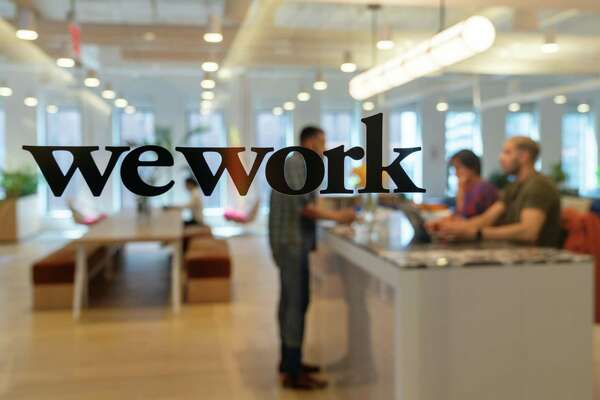 Wework signage on the entrance doors of the 85 Broad Street offices in the Manhattan borough of New York, on May 22, 2019.