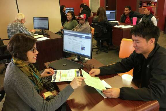 Cristina Cave, community relations senior manager for BakerRipley, helps complete a neighbor's tax return at one of 11 free preparation centers across the Houston area last year. Currently, BakerRipley is seeking volunteers to help taxpayers keep all their refunds during the new tax season.