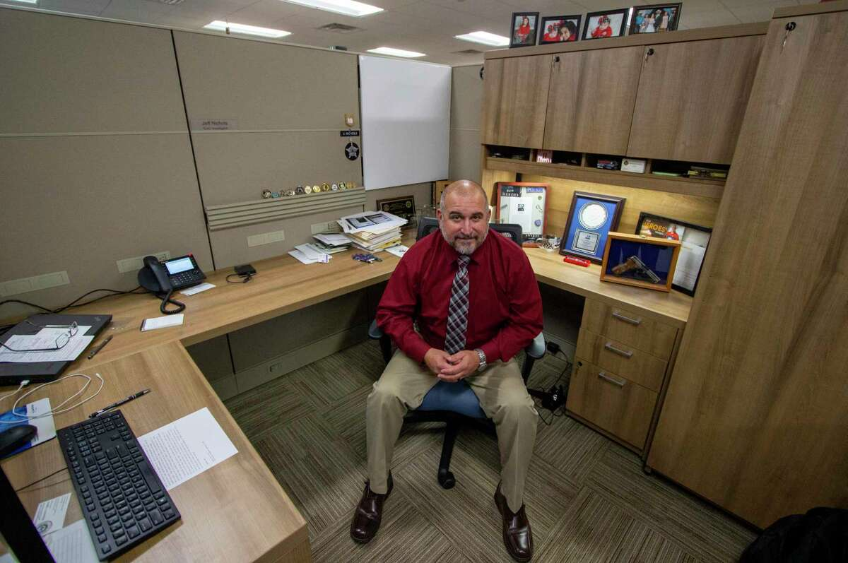 Det. Jeff Nichols sits in his office area Thursday, November 14, 2019 at The Conroe Police Department. Nichols recently finished working with the Montgomery County Internet Crimes Against Children task force where he spent about six years targeting child predators online, leading to nearly 50 convictions.