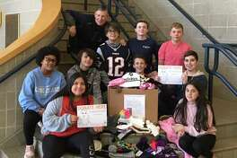 The Shelton Intermediate School Student Council donated more than 100 soft hats for juvenile cancer patients as part of Hatsgiving.