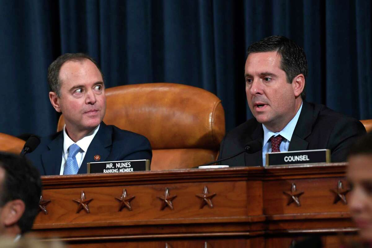 Chairman of the House Intelligence Committee Adam Schiff, D-Calif., left, listens as tracking member rep. Devin Nunes, R-Calif., questions former U.S. Ambassador to Ukraine Marie Yovanovitch at the House Intelligence Committee on Capitol Hill in Washington, Friday, Nov. 15, 2019, in the second public impeachment hearing of President Donald Trump's efforts to tie U.S. aid for Ukraine to investigations of his political opponents.