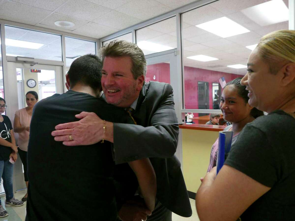 Southside ISD Superintendent Mark Eads embraces student Mark Gomez on the first day of registration at the start of the 2017-18 school year. Mark was headed to mddle school.