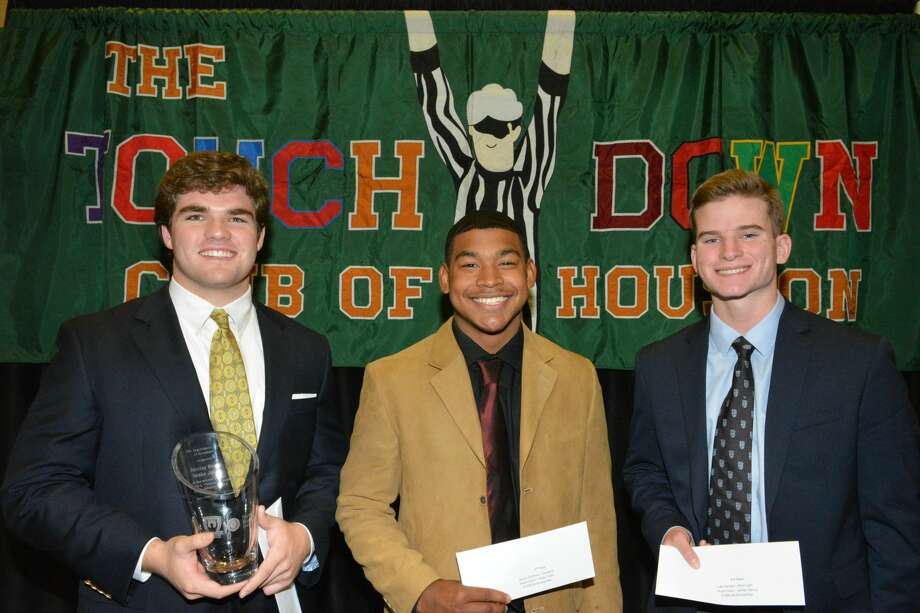 From left, Strake Jesuit's Barclay Briggs, Pearland's Anton Simieou and Klein Cain's Luke Pardee, were honored at the Touchdown Club of Houston's 21st annual luncheon Wednesday. Photo: Contributed Photo/Neal Farmer