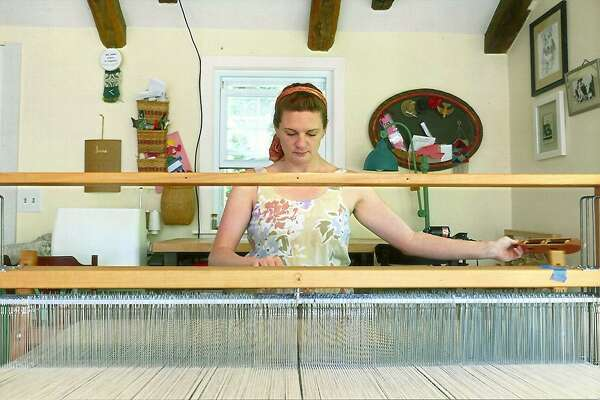 Katie Strano working at her Heddle Loom.