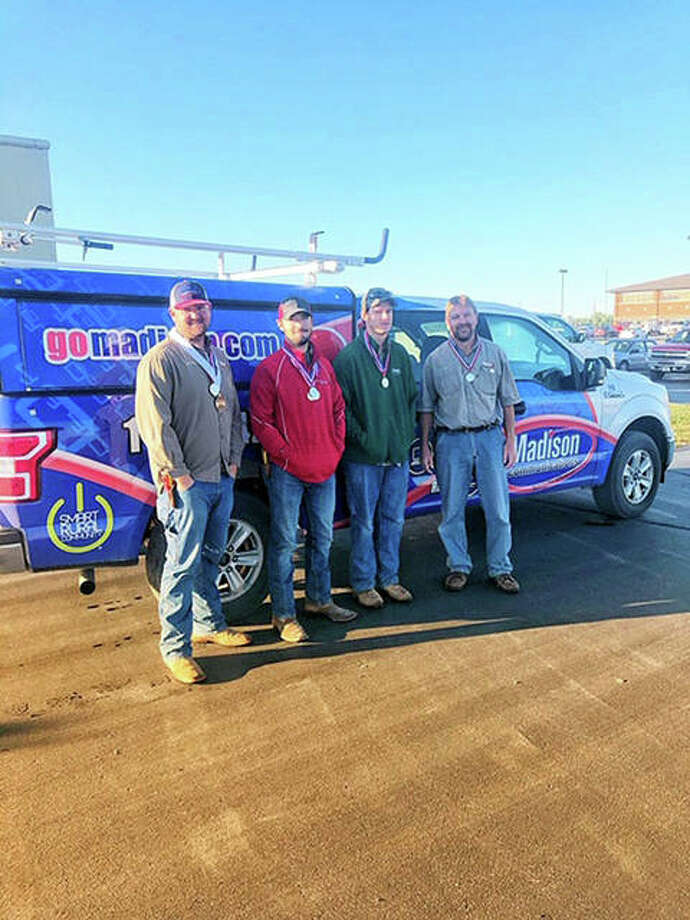 Madison Communication technicians Jeremy Maggart, Bobby Wicke, Brent Philips and Darin Jansen.