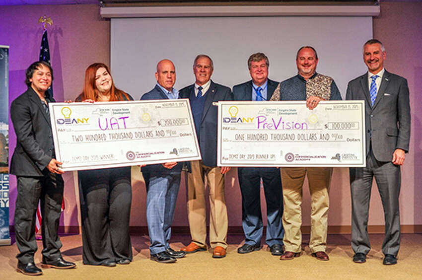 Daryian Rhysing and Evaguel Rhysing, founders of United Aircraft Technologies; John Liddy, Director of the AFRL Commercialization Academy; Bill Wolf, President of Griffiss Institute; William Harrison, Director, Small Business, AFRL Headquarters, Wright-Patterson AFB; Greg Walker, co-founder PreVision; and Dr. Michael Hayduk, Deputy Director, Information Directorate, AFRL