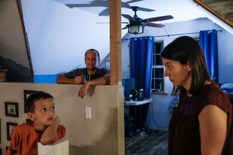 Jason Dyer (center) looks on as his son Adrik, 11 chats with his wife Mikalia (right) in their house in Paradise, California, on Tuesday, Nov. 12, 2019. Jason, a firefighter, was trapped on a small road during the Kincade fire last month and was forced to deploy his fire shelter to help save himself and two other civilians in Geyserville. Photo: Gabrielle Lurie / The Chronicle