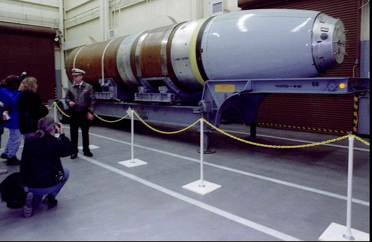 Caption:A Trident I nuclear missile mockup dwarfs Navy Capt. Paul R. Cochran as the commander of Bangor's Strategic Weapons Facility Pacific (cq title) briefs reporters on how Russian officials will inspect his highly classified facility. Under the 1991 START I (cq) Treaty, the United States and Russian teams will tour 34 American and 68 former Soviet nuclear sites. 2/23/95 Photographer:Phil H. Webber Keyword:Trident Keyword:Missile Keyword:Nuclear Keyword:Navy Keyword:START Keyword:Mock-up Keyword:ICBM