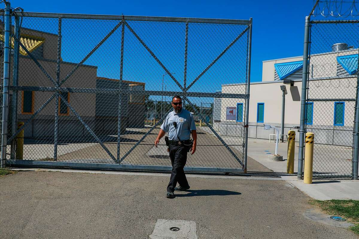 An officer opens a gate at the Fresno County Juvenile Hall in Fresno, California, on Tuesday, Sept. 17, 2019.