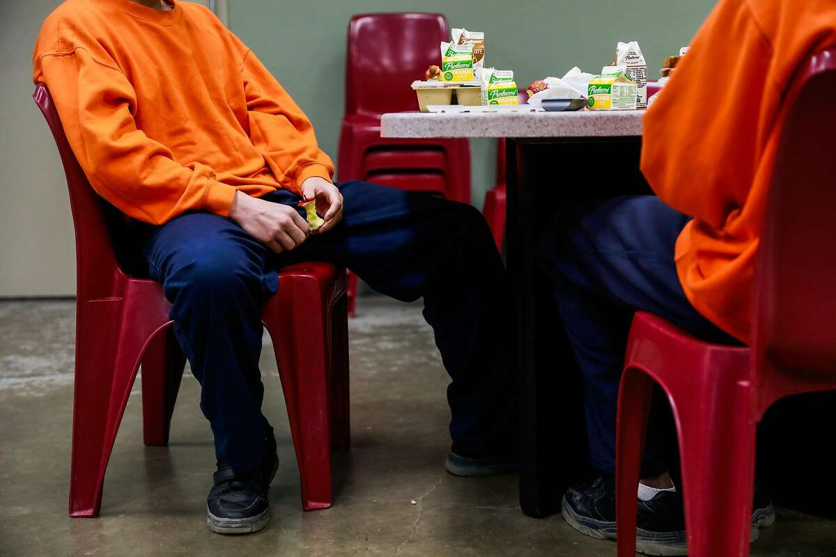 Youths eat lunch at the Fresno County Juvenile Hall in Fresno, California, on Tuesday, Sept. 17, 2019.