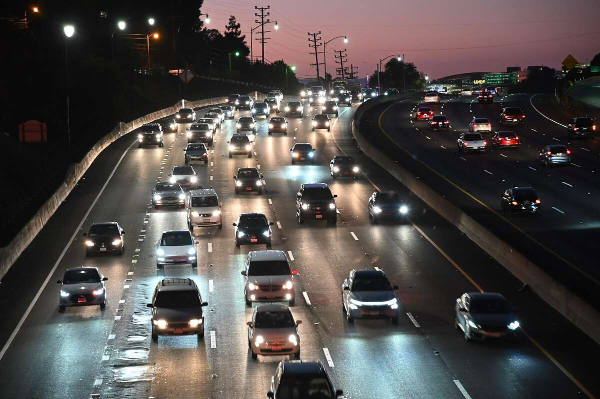 (FILES) In this file photo taken on September 17, 2019 motor vehicles drive on the 101 freeway in Los Angeles, California. - Carmaking heavyweights General Motors, Toyota and Fiat Chrysler have backed President Donald Trump's efforts to ban California from maintaining its own stricter standards on car emissions, the auto giants have confirmed. The announcement is the latest salvo in a months-long battle over car pollution between the White House and the US state, whose Democratic leaders have made fighting climate change a priority.The three automakers announced October 28, 2019 that they would support Washington in that legal action. (Photo by Robyn Beck / AFP) (Photo by ROBYN BECK/AFP via Getty Images)