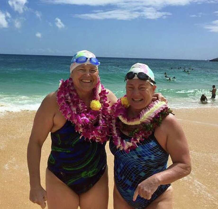 Westport's Elizabeth Fry (right) on Sandy Beach after swimming 17 hours 30 minutes across the 42 kilometer Molokai Channel from Molokai Island to Oahu in Hawaii lin 2016. Photo: Contributed / Photo