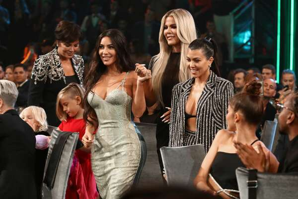 SANTA MONICA, CALIFORNIA - NOVEMBER 10: 2019 E! PEOPLE'S CHOICE AWARDS -- Pictured: (l-r) Kris Jenner, Kim Kardashian West, Khloé Kardashian, and Kourtney Kardashian win The Reality Show of 2019 award during the 2019 E! People's Choice Awards held at the Barker Hangar on November 10, 2019 -- NUP_188993 (Photo by: Christopher Polk/E! Entertainment/NBCU Photo Bank)