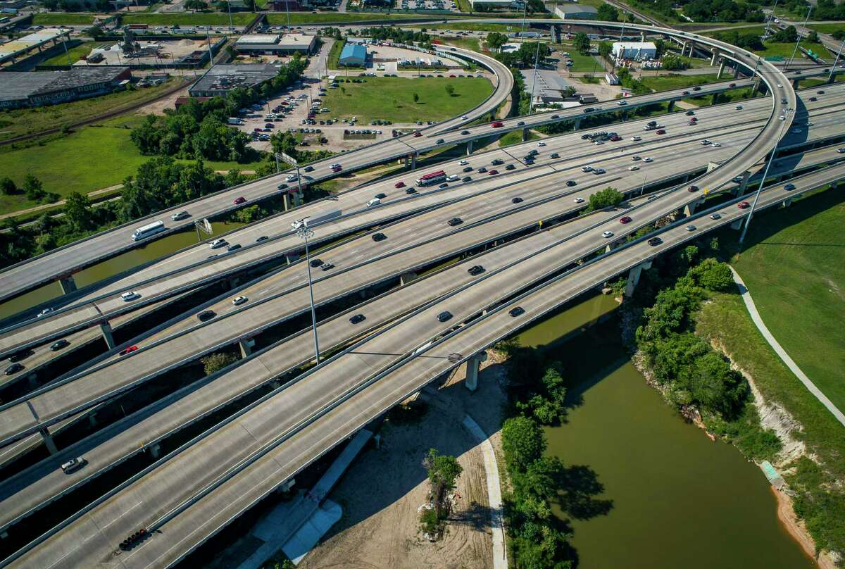 Interstate 69 traffic crosses Buffalo Bayou northeast of downtown next to the Clayton Homes, a Houston Housing Authority complex in Houston on June 12, 2019. Clayton Homes would be demolished if current plans for redevelopment of Interstate 45 proceed as planned.