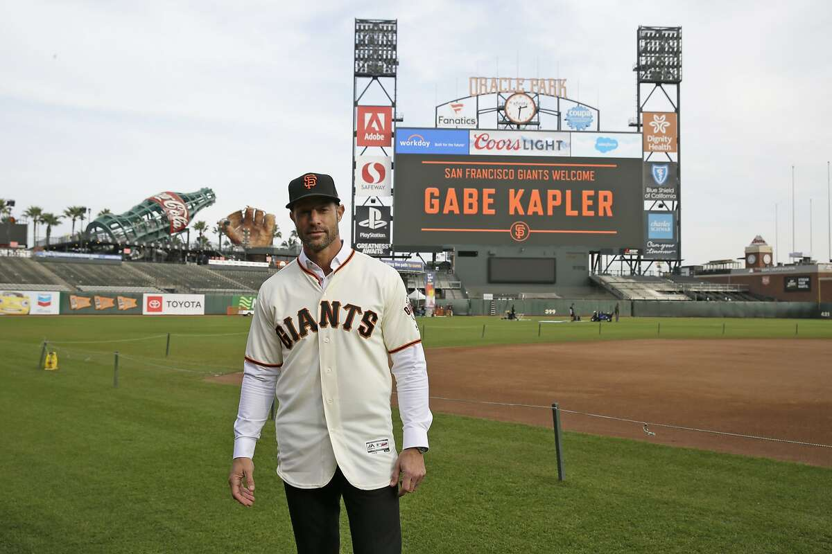 San Francisco Giants manager Gabe Kapler poses on the field at Oracle Park after being introduced Wednesday, Nov. 13, 2019, in San Francisco. Kapler has been hired as manager of the San Francisco Giants, a month after being fired from the same job by the Philadelphia Phillies. Kapler replaces Bruce Bochy, who retired at the end of the season following 13 years and three championships with San Francisco. (AP Photo/Eric Risberg)